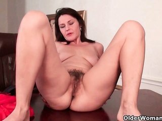 melodious milf works her woolly cunt
